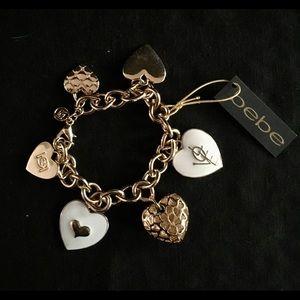 bebe Gold and White Enamel Heart Charm Bracelet